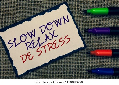Text sign showing Slow Down Relax De Stress. Conceptual photo Have a break reduce stress levels rest calm Blue bordered page drawn some texts laid color pen jute background.