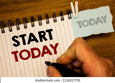 Text sign showing Start Today. Conceptual photos Initiate Begin right now Inspirational Motivational phraseMan creating for today on notebook Hand hold holding pen Wooden background.