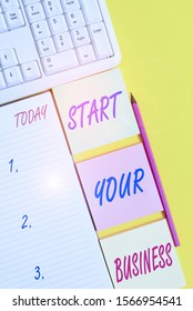 Text sign showing Start Your Business. Conceptual photo going into a New Venture Create New Product Services Empty papers with copy space on the yellow background table.