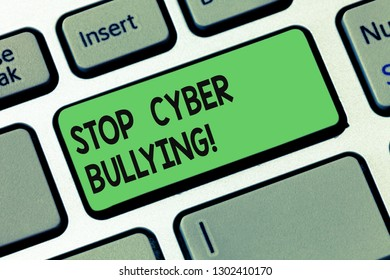 Text sign showing Stop Cyber Bullying. Conceptual photo prevent use of electronic communication bully demonstrating Keyboard key Intention to create computer message pressing keypad idea.