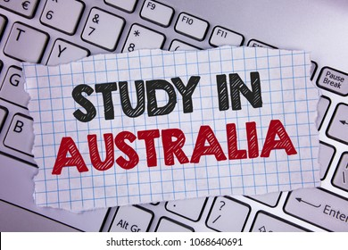 Text sign showing Study In Australia. Conceptual photo Graduate from oversea universities great opportunity written on Tear Notebook paper placed on the Laptop.