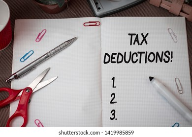 Text sign showing Tax Deductions. Conceptual photo reduction income that is able to be taxed of expenses Scissors and writing equipments plus math book above textured backdrop.