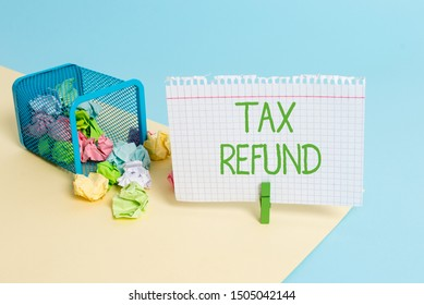 Text sign showing Tax Refund. Conceptual photo refund on tax when the tax liability is less than the tax paid Trash bin crumpled paper clothespin empty reminder office supplies tipped.