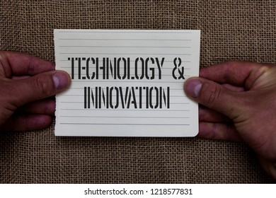 Text sign showing TechnologyandInnovation. Conceptual photo Application of better Solution for New Market Needs Man holding piece notebook paper jute background Communicating ideas.