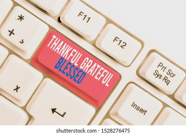Text sign showing Thankful Grateful Blessed. Conceptual photo Appreciation gratitude good mood attitude White pc keyboard with empty note paper above white background key copy space.