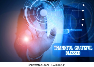 Text sign showing Thankful Grateful Blessed. Conceptual photo Appreciation gratitude good mood attitude Male human wear formal work suit presenting presentation using smart device.