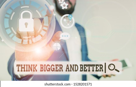Text sign showing Think Bigger And Better. Conceptual photo no Limits be Open minded Positivity Big Picture Male human wear formal work suit presenting presentation using smart device.