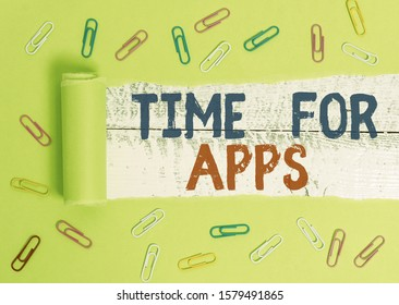 Text sign showing Time For Apps. Conceptual photo The best fullfeatured service that helps communicate faster Paper clip and torn cardboard placed above a wooden classic table backdrop.