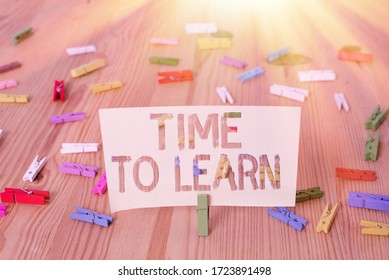 Text sign showing Time To Learn. Conceptual photo the need to get knowledge or understanding of facts and ideas Colored clothespin papers empty reminder wooden floor background office.