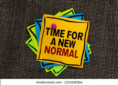 Text sign showing Time For A New Normal. Conceptual photo Make a big dramatic change Replace the expected Black bordered different color sticky note stick together with pin on jute sack.