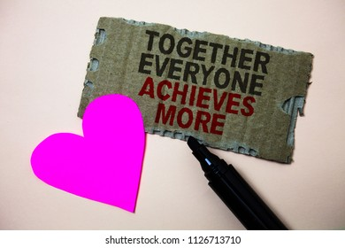 Text sign showing Together Everyone Achieves More. Conceptual photo Teamwork Cooperation Attain Acquire Success Brown paperboard rough ideas message heart wild love lovely intentions.