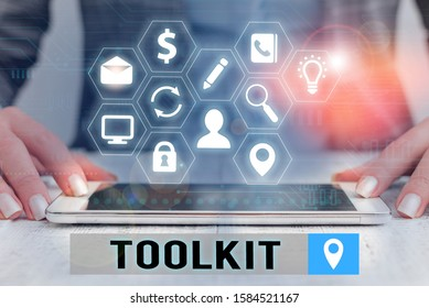 Text sign showing Toolkit. Conceptual photo set of tools kept in a bag or box and used for a particular purpose.