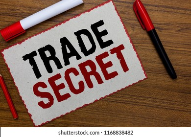 Text sign showing Trade Secret. Conceptual photo Confidential information about a product Intellectual property White paper red borders markers wooden background communicating ideas.