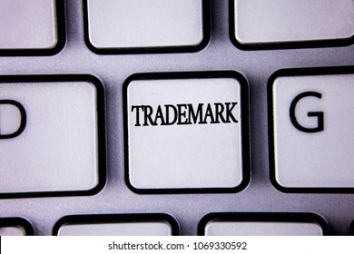 Text sign showing Trademark. Conceptual photo Legally registered Copyright Intellectual Property Protection written on White Keyboard Key with copy space. Top view.
