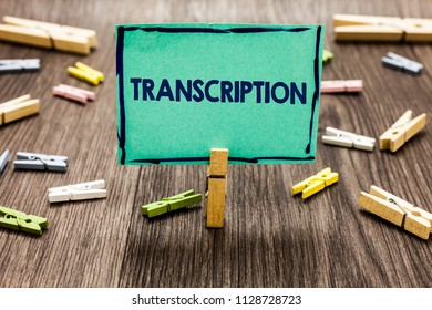 Text sign showing Transcription. Conceptual photo Written or printed process of transcribing words text voice Random clips art work board creative nice paperclips wood grey shadow.