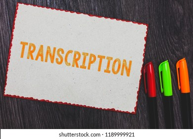 Text sign showing Transcription. Conceptual photo Written or printed version of something Hard copy of audio White paper red borders colorful markers wooden background expressing ideas.