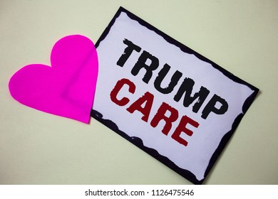 Text sign showing Trump Care. Conceptual photo refers to replacement for Affordable Care Act in united states Hart love pink white background love lovely thoughts message memories.