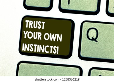 Text sign showing Trust Your Own Instincts. Conceptual photo Intuitive follow demonstratingal feelings confidence Keyboard key Intention to create computer message pressing keypad idea.