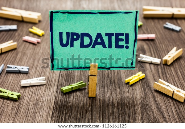 Text sign showing Update Motivational Call. Conceptual photo Up to date with latest developments updated Random clips art work board creative nice paperclips wood grey shadow.