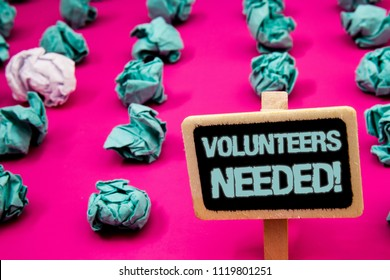 Text sign showing Volunteers Needed Motivational Call. Conceptual photo Social Community Charity Volunteerism Blackboard with white letter pink base much green paper lobs big white lob.