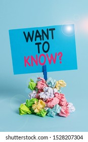 Text sign showing Want To Know Question. Conceptual photo Request for information Asking Wonder Need Knowledge Reminder pile colored crumpled paper clothespin reminder blue background.