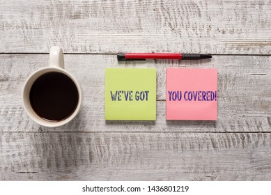 Text sign showing We Ve Got You Covered. Conceptual photo have done gotten or provided whatever needed Stationary placed next to a cup of black coffee above the wooden table.