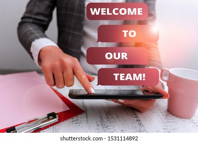 Text sign showing Welcome To Our Team. Conceptual photo introducing another demonstrating to your team mates Business concept with mobile phone in the hand.