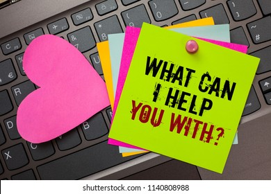 Text sign showing What Can I Help You With question. Conceptual photo Offering assistance Experts advice ideas Bright colorful written papers pinch by pin pink heart on computer keyboard.