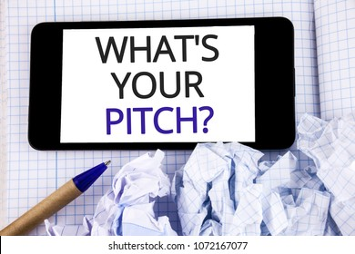 Text sign showing What Is Your Pitch Question. Conceptual photo Present proposal Introducing Project or Product written Mobile Phone Screen placed Notebook Pen next to it.