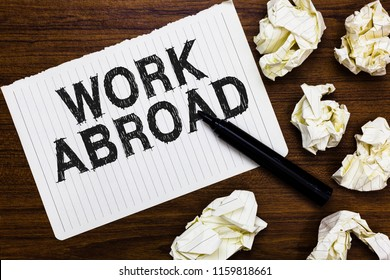 Text sign showing Work Abroad. Conceptual photo Immersed in a foreign work environment Job Overseas Non Local Marker over notebook crumpled papers ripped pages several tries mistakes.
