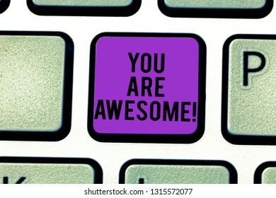 Text sign showing You Are Awesome. Conceptual photo To have a great opinion about someone Admiration Wonder Keyboard key Intention to create computer message pressing keypad idea.