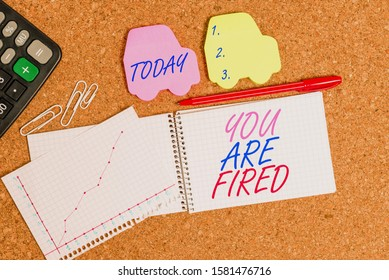 Text sign showing You Are Fired. Conceptual photo Getting out from the job and become jobless not end the career Desk notebook paper office cardboard paperboard study supplies table chart.