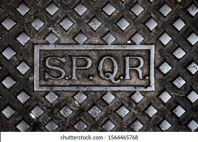 the text SPQR, abbreviation for Senatus Populusque Romanus, the latin expression for the Senate and People of Rome, in a cast iron manhole cover of the public sewerage in Rome, Italy