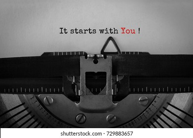 Text It starts with You typed on retro typewriter