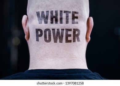 """The text tattoo """"WHITE POWER"""" is on the man's nape. A concept of white supremacists."""