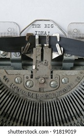 text 'THE BIG IDEA' written in an old typewriter, vertical composition