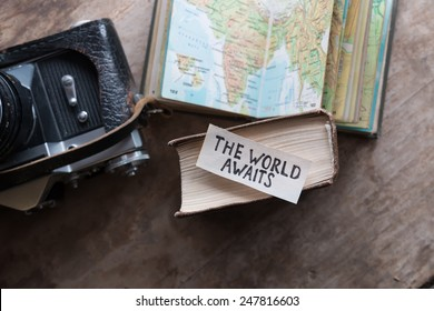 "text ""The World Awaits"" and book, travel, tour, tourism concept"