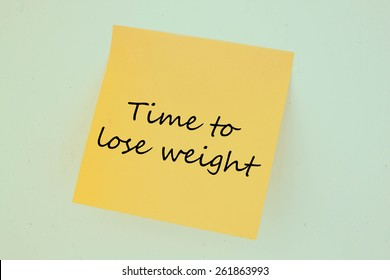 Text time to lose weight on the short note texture background