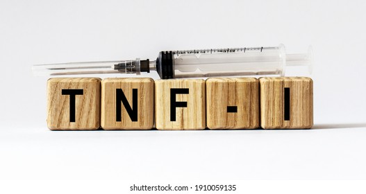 Text TNF-I made from wooden cubes. White background