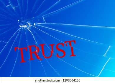 The text Trust on the broken glass. Deceived trust. Lie concept. Background
