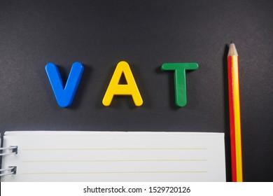 Text VAT on paper white&black background business finance design