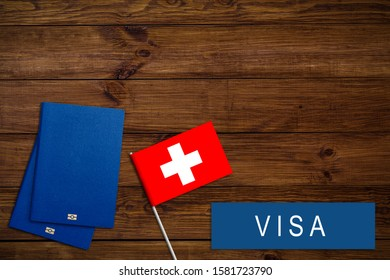 text VISA on Swiss visa passport, passport traveling abroad concept. Visit, Travel to Swiss concept - selective focus. Immigration and emigration concept