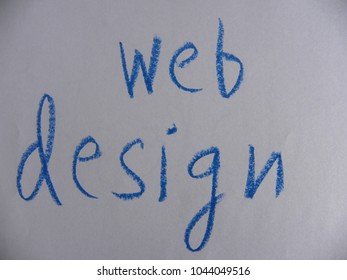 Text web design hand written by blue oil pastel on white color paper