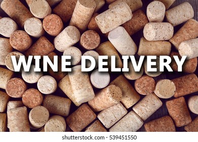 Text WINE DELIVERY on corks background. Logistics and wholesale concept