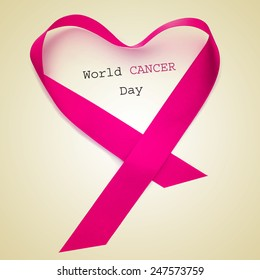 the text world cancer day and a pink ribbon forming a heart on a beige background