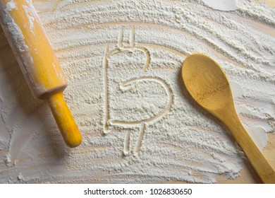 Text written on scattered flour. Bitcoin concept