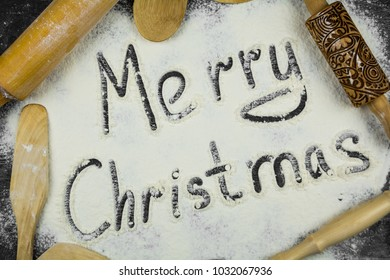 Text written on scattered flour. Merry Christmas concept