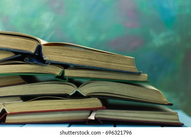 Textbooks and books on a blue wooden table. Beautiful background.