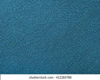 textile background - dark blue green silk fabric with Crepe chiffon (crape chiffon) weave pattern of threads close up