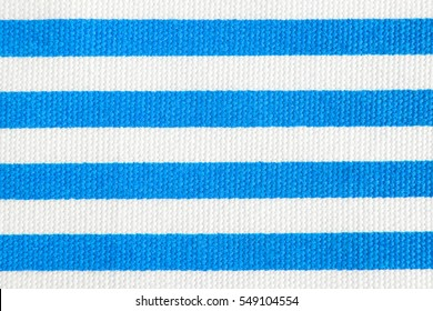 Textile background with light blue and white stripes. Fabric texture